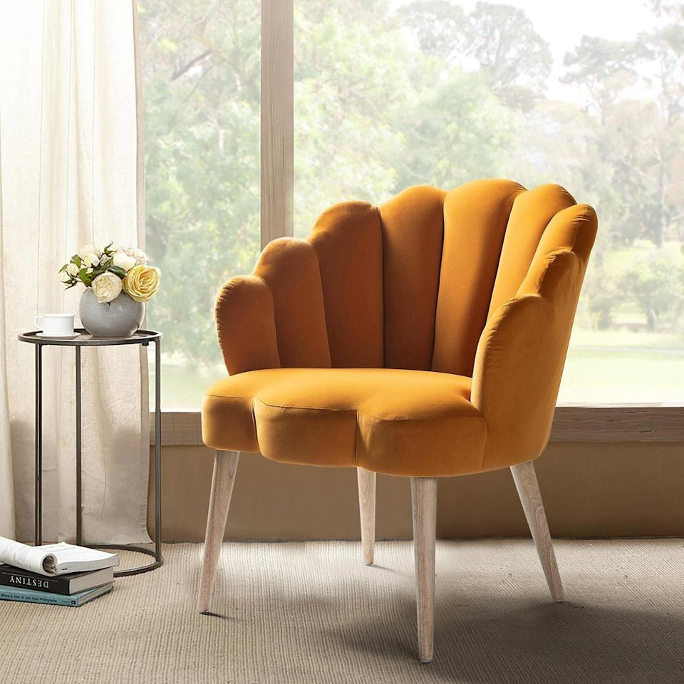 <p>Add a bright pop of color to any room with this <span>Aliecia Velvet Arm Chair</span> ($198, originally $220).</p>