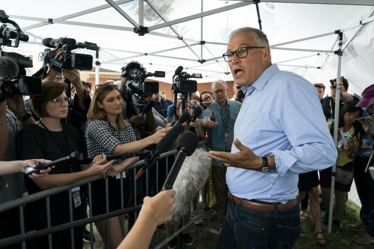 Democratic presidential candidate and Washington Governor Jay Inslee speaks with reporters at the Iowa State Fair August 10, 2019 in Des Moines, Iowa (AFP Photo/ALEX EDELMAN)