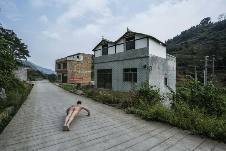 Ou Zhihang was detained after taking nude photographs in Bije, Guizhou where four children drank pesticide after being abandoned