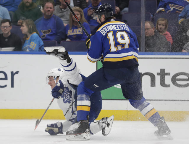 St. Louis Blues' Jay Bouwmeester (19) sends Toronto Maple Leafs' Zach Hyman (11) to the ice, after a collision during the first period of an NHL hockey game Tuesday, Feb. 19, 2019, in St. Louis. (AP Photo/Tom Gannam)