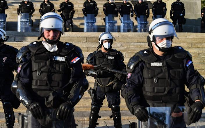 Police were equipped with riot gear to meet protesters, who have been violent in some areas - ANDREJ ISAKOVIC/AP