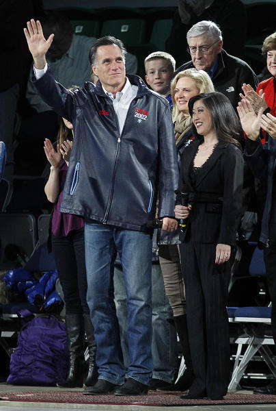 Republican presidential candidate, former Massachusetts Gov. Mitt Romney, arrives with former Olympic figure skating medalist Kristi Yamaguchi to speak at the start of 'A Tribute to Salt Lake 2002 featuring Stars on Ice,' in Salt Lake City, Saturday, Feb. 18, 2012. (AP Photo/Gerald Herbert)