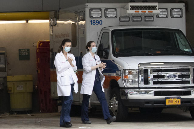 Medical personnel leave the emergency room at New York-Presbyterian Lower Manhattan Hospital on Wednesday. (Mary Altaffer/AP)