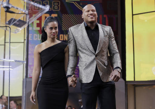 Ryan Shazier, right, walks with his wife Michelle to announce the Pittsburgh Steelers selection in the first round of the NFL football draft, Thursday, April 26, 2018, in Arlington, Texas. (AP Photo/David J. Phillip)