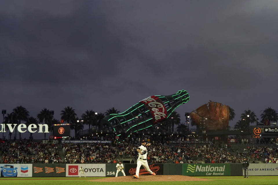 San Francisco Giants' Jarlin Garcia, bottom, pitches against the San Diego Padres during the second inning of a baseball game in San Francisco, Wednesday, Sept. 15, 2021. (AP Photo/Jeff Chiu)