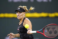 Angelique Kerber, of Germany, hits a forehand to Paula Badosa, of Spain, at the BNP Paribas Open tennis tournament Thursday, Oct. 14, 2021, in Indian Wells, Calif. (AP Photo/Mark J. Terrill)