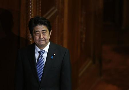 Japan's Prime Minister Abe walks after delivering his policy speech at the lower house of parliament in Tokyo