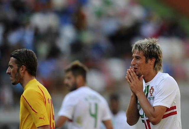 Portugal´s defender Fabio Coentrao (R) reacts during the friendly football match against Macedonia at Magalhaes Pessoa Stadium in Leiria on May 26, 2012, in preperation for the upcoming Euro 2012 football championship, which will take place in Poland and Ukraine from June 8 to July 1. AFP PHOTO/ FRANCISCO LEONGFRANCISCO LEONG/AFP/GettyImages