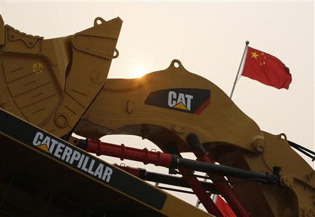 A Caterpillar excavator is displayed at the China Coal and Mining Expo 2013 in Beijing
