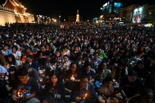 People gather for a candlelight vigil in Nakhon Ratchasima, Thailand, following a mass shooting which Prime Minister Prayut Chan-O-Cha called unprecedented