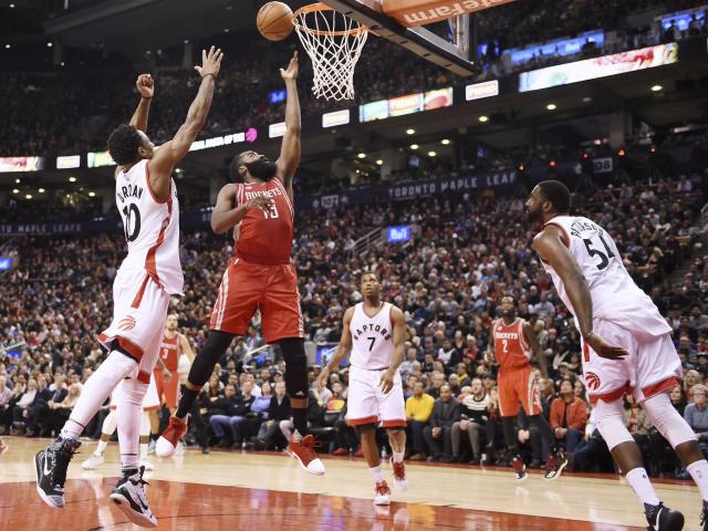 James Harden (center) has earned DeMar DeRozan's (left) vote for MVP. (Frank Gunn/The Canadian Press via AP)