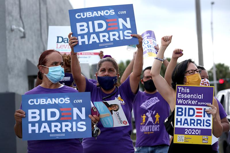 MIAMI SPRINGS, FLORIDA - OCTOBER 11: People show their support as they participate in a caravan for Democratic presidential nominee Joe Biden event on October 11, 2020 in Miami Springs, Florida. The caravan was held by people from the South Florida AFL-CIO, including LIUNA, IBEW, IUPAT, SFBCTC, SEIU, TWU Local 291, United Teachers of Dade, AFSCME, American Postal Workers Union and others, as part of a countywide caravan in support of Joe Biden. (Photo by Joe Raedle/Getty Images)