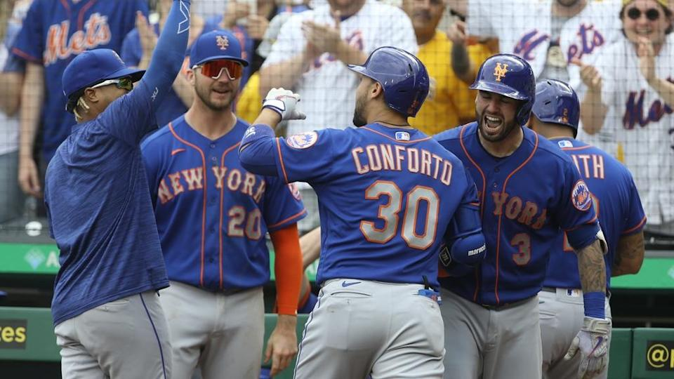 Michael Conforto greeted at home plate after go-ahead homer against Pirates July 2021