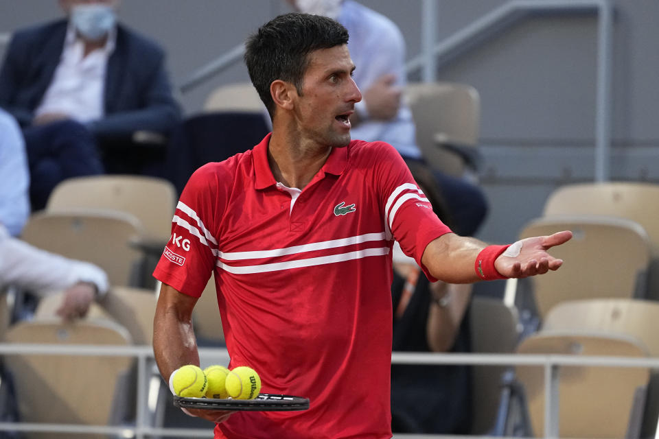 Serbia's Novak Djokovic gestures as he plays Spain's Rafael Nadal during their semifinal match of the French Open tennis tournament at the Roland Garros stadium Friday, June 11, 2021 in Paris. (AP Photo/Michel Euler)