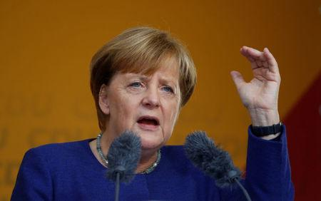 German Chancellor Angela Merkel, a top candidate of the Christian Democratic Union Party (CDU) for the upcoming general elections, gestures as she speaks during an election rally in Fritzlar, Germany September 21, 2017. REUTERS/Kai Pfaffenbach