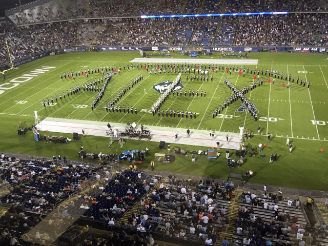 "Alex Schachter, who was killed in the February shooting at Marjory Stoneman Douglas High School, is honored by the Connecticut marching band, which spelled out the word ""Alex"" during its halftime show at the NCAA college football game against Central Florida on Thursday, Aug. 30, 2018, in East Hartford, Conn. (AP Photo/Pat Eaton Robb"