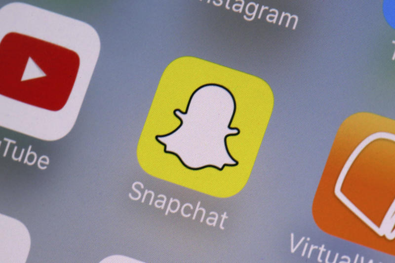 More than half of those who use Snap Chat while driving said they do so to take a photo or video of something. Source: AP Photo/Richard Drew.