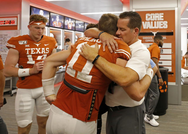 Texas Longhorns offensive coordinator Tim Beck hugs quarterback Sam Ehlinger after their 45-38 loss to the LSU Tigers Saturday Sept. 7, 2019 at Darrell K Royal-Texas Memorial Stadium in Austin, Tx. ( Photo by Edward A. Ornelas )