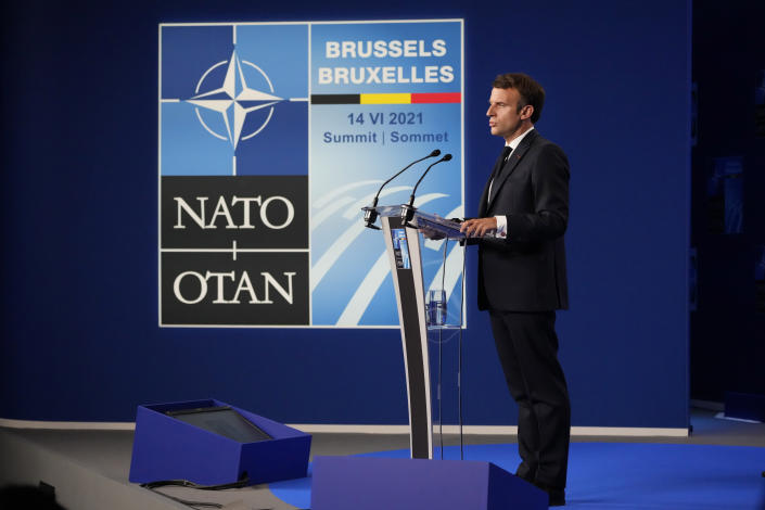 French President Emmanuel Macron speaks during a media conference at the end of a NATO summit in Brussels, Monday, June 14, 2021. (AP Photo/Francois Mori)