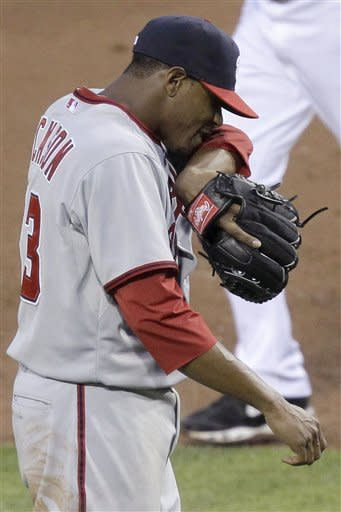 Washington Nationals pitcher Edwin Jackson walks to the dugout after giving up two home runs in the fourth inning of a baseball game against the Pittsburgh Pirates in Pittsburgh on Tuesday, May 8, 2012. (AP Photo/Gene J. Puskar)