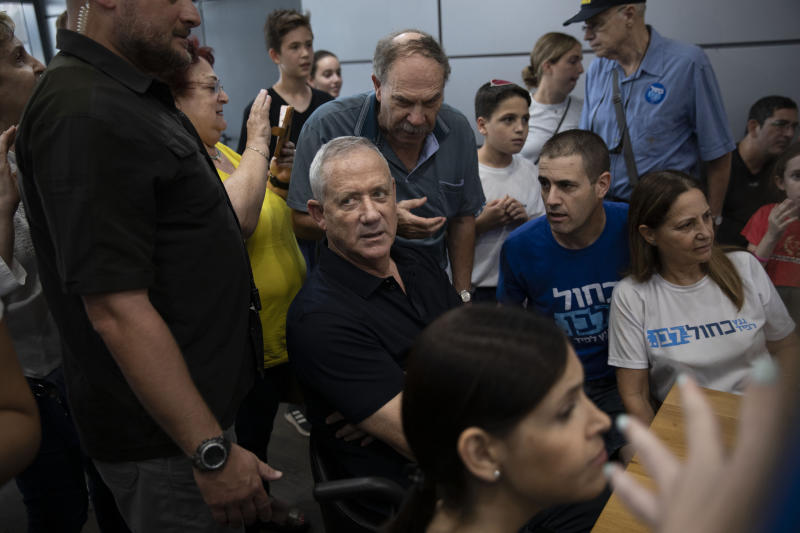 In this Friday, Sept. 6, 2019 photo, Blue and White party leader and former IDF chief of staff Benny Gantz, surrounded by his supporters during an election campaign rally at a mall in Kiryat Ono, Israel. (AP Photo/Oded Balilty)