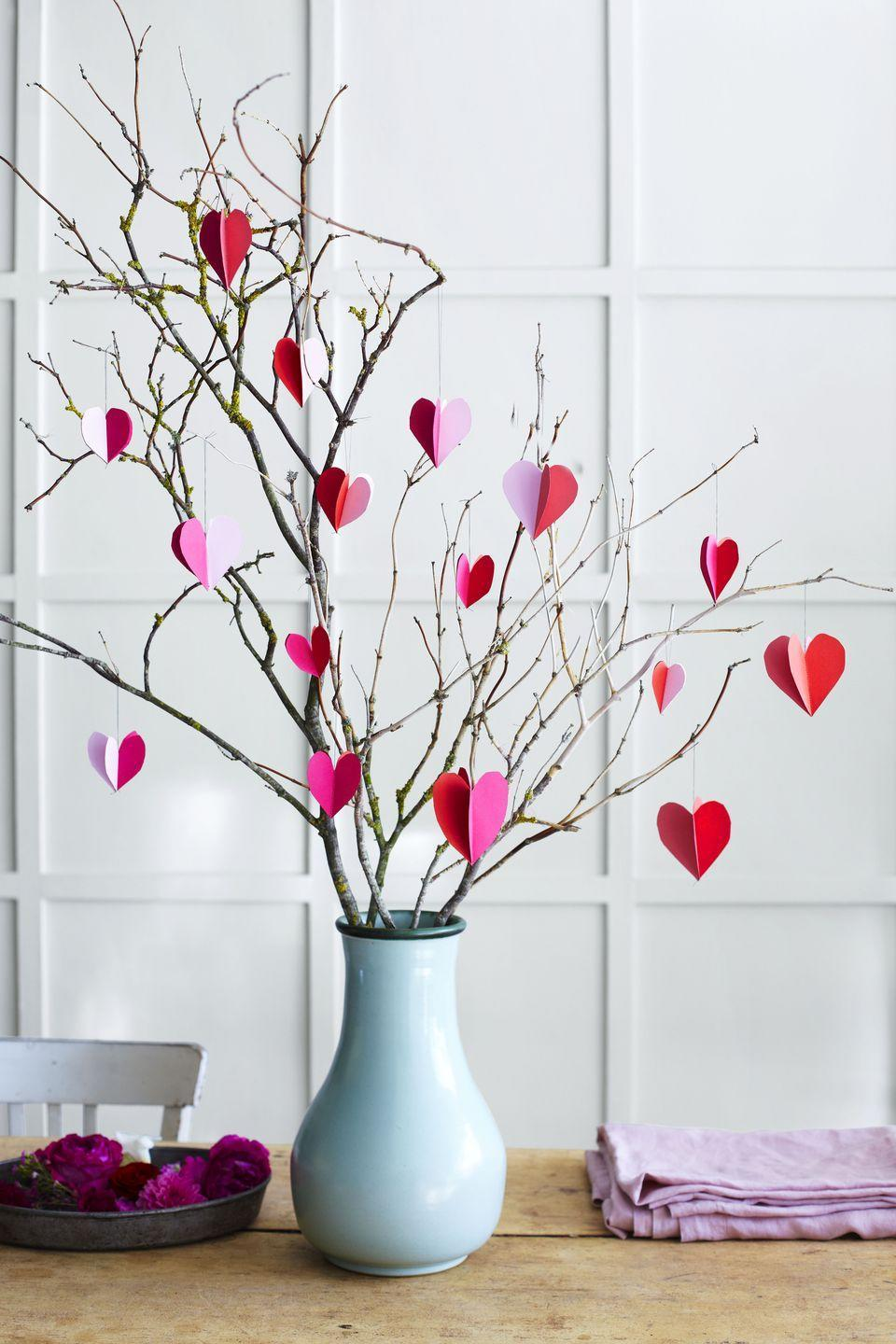 <p>Fill a vase with backyard branches, and hang individual paper ornaments made from card stock and thread to create a beautiful centerpiece for Mom on Mother's Day. Bonus: Write sweet reasons you love her on the hearts!<br></p>
