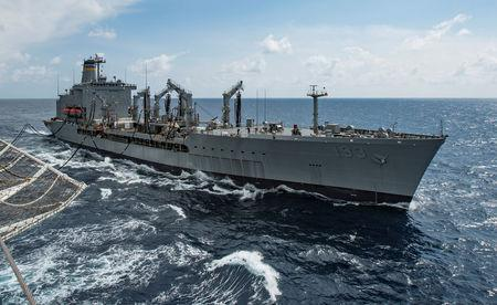 Military Sealift Command fleet replenishment oiler USNS Walter S. Diehl (T-AO 193) pulls alongside hospital ship USNS Mercy (T-AH 19) to deliver supplies and mail by a connected replenishment in the South China Sea August 15, 2016. PU.S. Marine Corps photo by Sgt. Brittney Vella/Handout via REUTERS/Files
