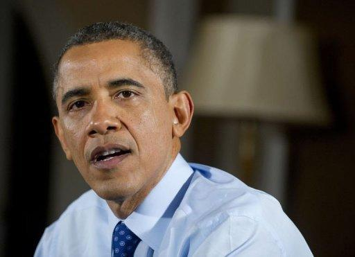 Obama warns of human cost of fiscal cliff