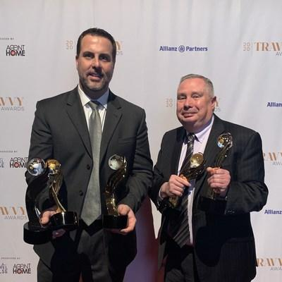 Jay Pope and Tony Cosenza of Enterprise Holdings accept the Travvy Awards in New York City on Feb. 12.