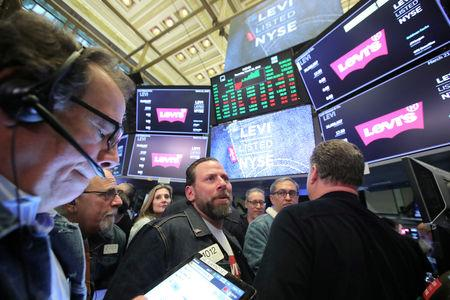 Traders wear Levis clothing during the Levi Strauss & Co. IPO at the New York Stock Exchange in New York