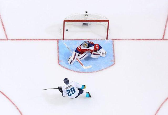"""<a class=""""link rapid-noclick-resp"""" href=""""/nhl/players/6369/"""" data-ylk=""""slk:Leon Draisaitl"""">Leon Draisaitl</a> #29 of Team Europe scores the overtime winning goal against <a class=""""link rapid-noclick-resp"""" href=""""/nhl/players/5114/"""" data-ylk=""""slk:Petr Mrazek"""">Petr Mrazek</a> #34 of Team Czech Republic during the World Cup of Hockey game at Air Canada Centre on September 19, 2016 in Toronto, Ontario, Canada. (Photo by Andre Ringuette/World Cup of Hockey via Getty Images)"""
