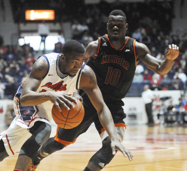 Mississippi's LaDarius White (10) drives against Mercer's Ike Nwamu (10) during an NCAA college basketball game Sunday, Dec. 22, 2013, in Oxford, Miss. (AP Photo/Oxford Eagle, Bruce Newman)