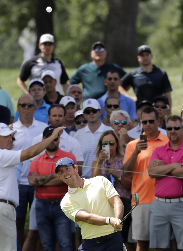 Rory Mcllroy watches his third shot on the seventh hole during the first round of the BMW Championship golf tournament at Medinah Country Club, Thursday, Aug. 15, 2019, in Medinah, Ill. (AP Photo/Nam Y. Huh)