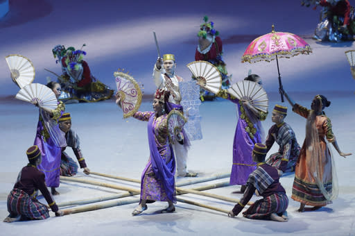 Dancers in traditional dress perform during the opening ceremony of the 30th South East Asian Games at the Philippine Arena, Bulacan province, northern Philippines on Saturday, Nov. 30, 2019. (AP Photo/Aaron Favila)