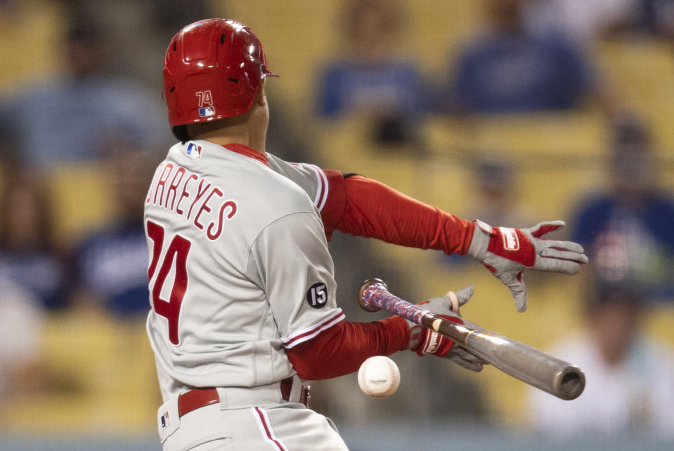 Philadelphia Phillies' Ronald Torreyes fouls off a pitch during the sixth inning of a baseball game against the Los Angeles Dodgers in Los Angeles, Monday, June 14, 2021. (AP Photo/Kyusung Gong)