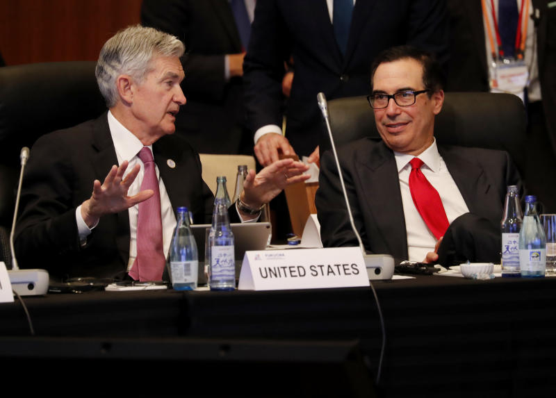 Federal Reserve Chairman Jerome Powell (L) talks with US Treasury Secretary Steven Mnuchin during the G20 finance ministers and central bank governors meeting in Fukuoka on June 8, 2019. (Photo by KIM KYUNG-HOON / POOL / AFP) (Photo credit should read KIM KYUNG-HOON/AFP via Getty Images)