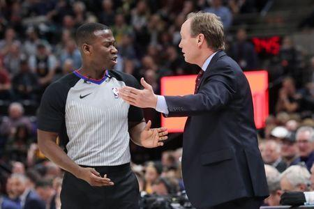 Mar 20, 2018; Salt Lake City, UT, USA; Atlanta Hawks head coach Mike Budenholzer argues with the referee during a stop in play in the 2nd quarter against the Utah Jazz at Vivint Smart Home Arena. Mandatory Credit: Chris Nicoll-USA TODAY Sports