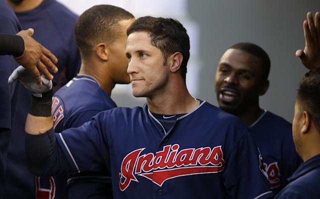 Cleveland Indians' Yan Gomes, center, is greeted in the dugout after he hit a solo home run against the Seattle Mariners in the sixth inning of a baseball game, Saturday, June 28, 2014, in Seattle. (AP Photo/Ted S. Warren)