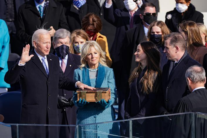 President Joe Biden (in Ralph Lauren), First Lady Jill Biden (in Markarian), Ashley Biden (in Gabriela Hearst), and Hunter Biden