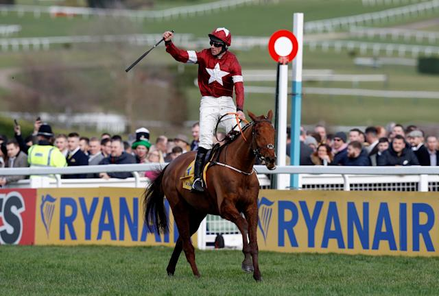 Horse Racing - Cheltenham Festival - Cheltenham Racecourse, Cheltenham, Britain - March 15, 2018 Davy Russell celebrates on Balko Des Flos after winning the 14:50 Ryanair Chase REUTERS/Darren Staples