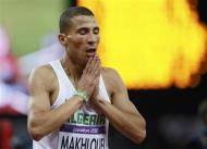 Algeria's Taoufik Makhloufi reacts after he won the men's 1500m final during the London 2012 Olympic Games at the Olympic Stadium August 7, 2012. REUTERS/Lucy Nicholson