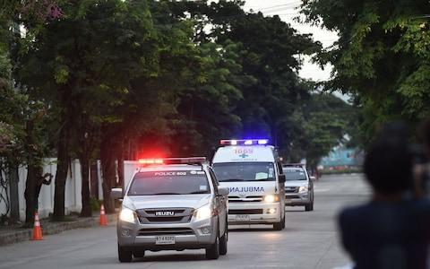 <span>An ambulance carrying members of the children's football team approaches the hospital in Chiang Rai</span> <span>Credit: LILLIAN SUWANRUMPHA /AFP </span>