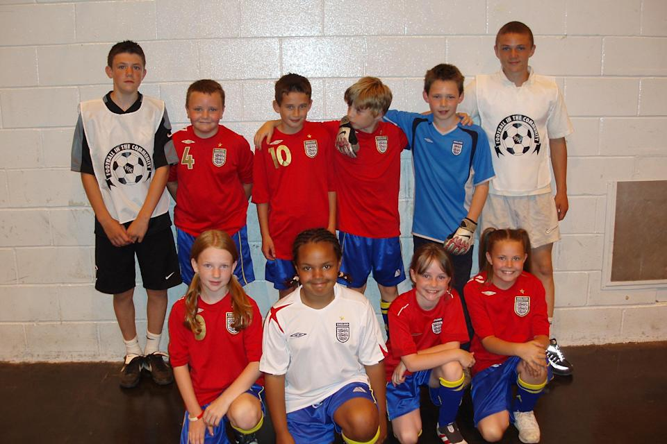 A 15-year-old Kieran Trippier with a team of primary school children he coached to victory in a mini-tournament