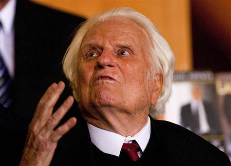 Billy Graham gestures while attending a book signing for former U.S. President George W. Bush's new book at the Billy Graham Library in Charlotte