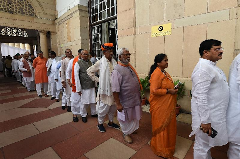 Indian members of parliament queue to cast their votes for the next president at Parliament House in New Delhi