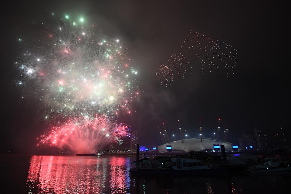 Fireworks and drones illuminate the night sky over London as they form a light display as London's normal New Year's Eve fireworks display was cancelled due to the coronavirus pandemic.