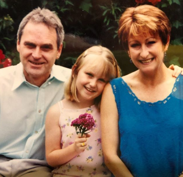 A photo of Lynne McGranger, her partner Paul McWaters and their daughter Clancy McWaters.