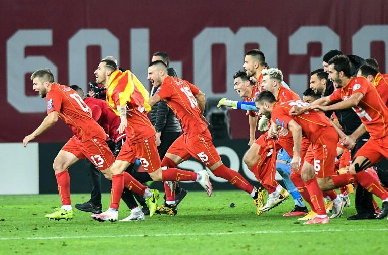 North Macedonia players celebrate after beating Georgia in Tbilisi to qualify for Euro 2020