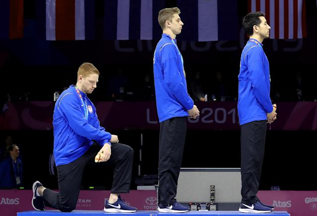 Gold medalist Race Imboden took a knee during the national anthem at the Pan American Games, a protest that would receive sanctions if done at the Olympics. (Photo by Leonardo Fernandez/Getty Images)
