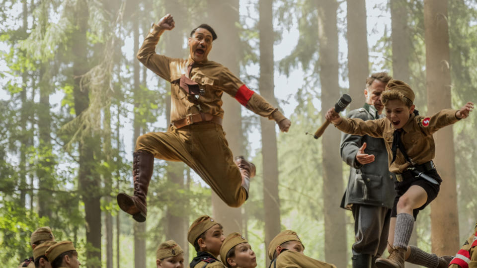 "Taika Waititi plays a Hitler Youth child's imaginary version of the Fuhrer <a href=""https://uk.movies.yahoo.com/taika-waititi-adolf-hitler-jojo-rabbit-trailer-162528498.html"" data-ylk=""slk:in this bizarre comedy;outcm:mb_qualified_link;_E:mb_qualified_link;ct:story;"" class=""link rapid-noclick-resp yahoo-link"">in this bizarre comedy</a>, which has already been divisive on the festival circuit. It's obviously the logical project to take on between Marvel behemoths. (Credit: Fox)"